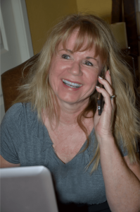 Janice talking with clients on her mobile phone